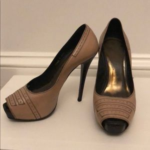 Italian made very high peep toe pumps